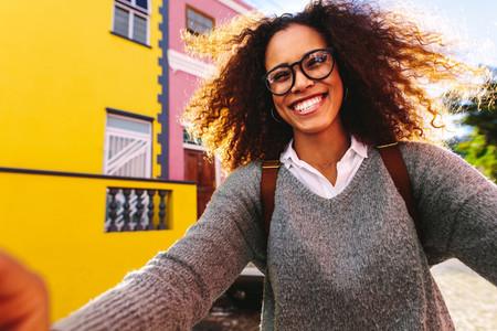 African girl traveler taking selfie outdoors