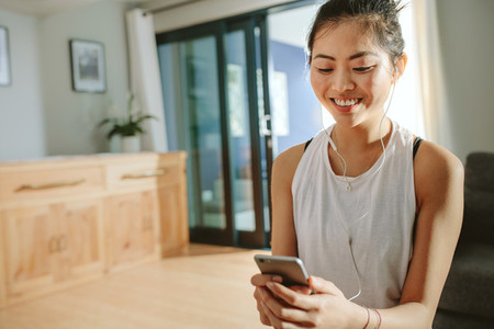 Woman taking break after exercising at home