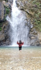 Lady and waterfall