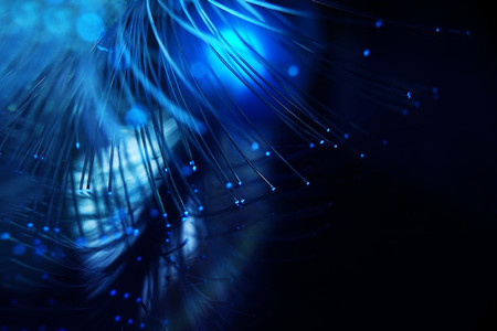 An amazing and vibrant macro of blue fiber optical pipes that il