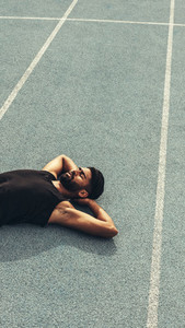 Athlete relaxing after the race on running track