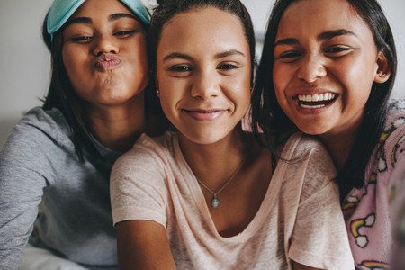 Girls having fun smiling and making faces for a selfie