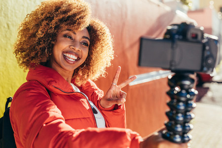 Female tourist recording content for her travel blog