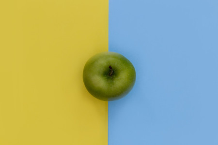 Minimal food green apple healthy fruit yellow blue background