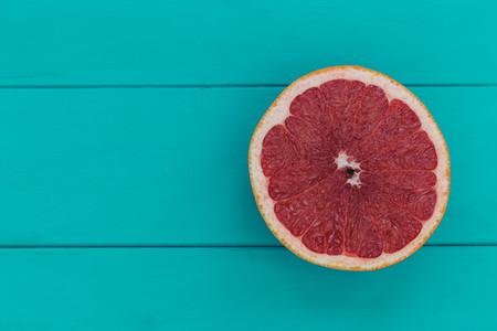 Minimal food pink grapefruit healthy fruit blue wood table backg