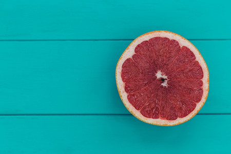 Minimal food pink grapefruit healthy fruit blue wood table backg