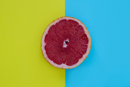 Minimal food pink grapefruit healthy fruit yellow blue backgroun