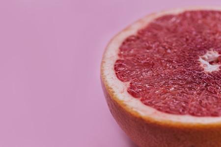 Minimal food pink grapefruit healthy fruit color background