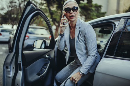 Female entrepreneur travelling to office in a luxurious car