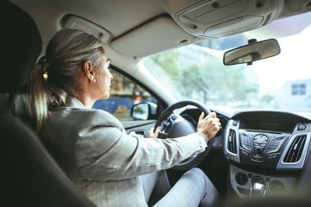 Senior businesswoman driving a car