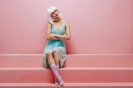 Glamorous female model on pink steps