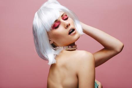 Sensual fashion model wearing artistic makeup