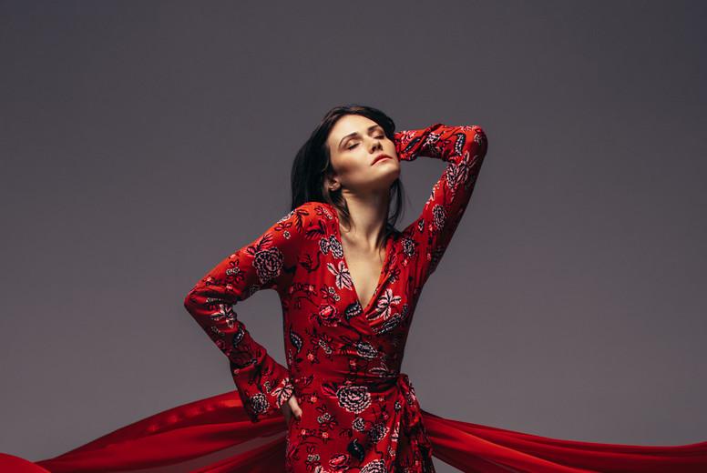 Sensual woman posing in red dress