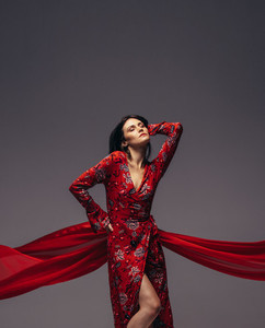 Sensual woman posing in red dress