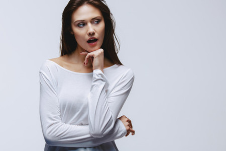 Attractive woman looking away at copy space