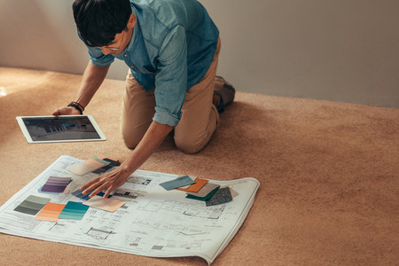 Designer selecting color scheme for new house project