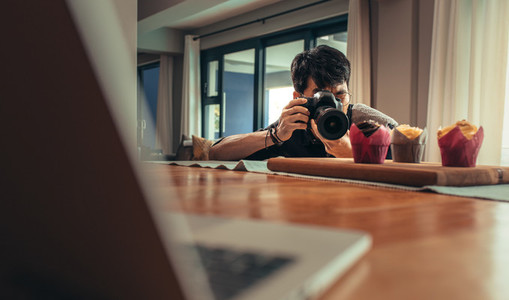 Food photographer shooting cupcakes in his studio