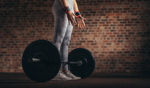 Woman doing weight lifting workout at gym