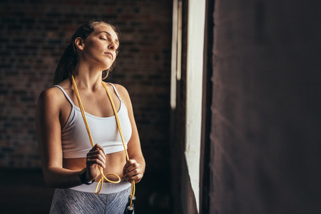 Fitness woman taking break after workout at gym
