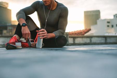 Man taking a break during workout listening to music