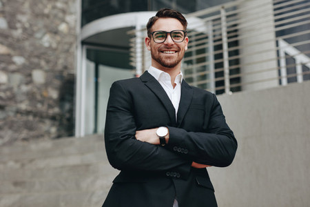 Portrait of a smiling businessman standing outdoors