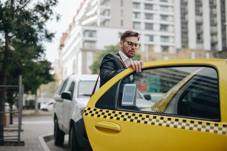 Entrepreneur boarding a cab