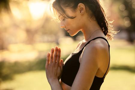 Woman at park practising meditation