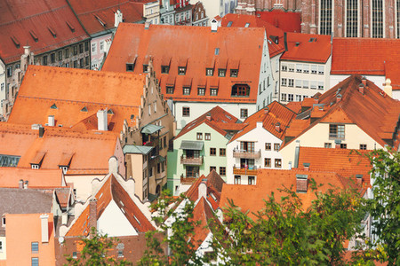 views of the red roofs of the city of landshut from a nearby hill