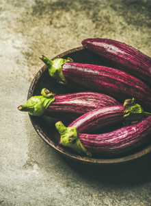 Fresh raw Fall harvest purple eggplants selective focus