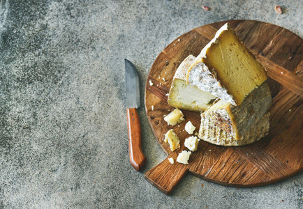 Cheese assortment on board copy space