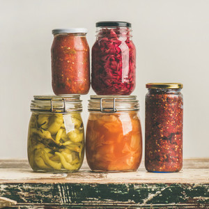 Autumn seasonal pickled or fermented vegetables in jars  square crop
