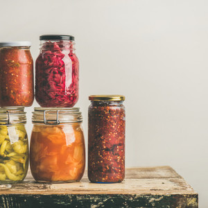 Autumn seasonal pickled or fermented vegetables in jars Home canning