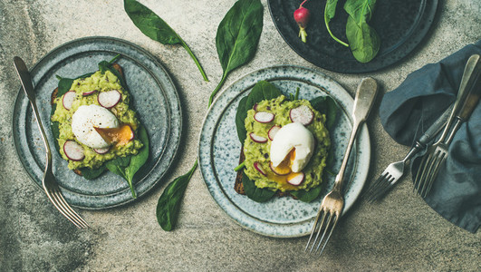 Healthy vegetarian breakfast flat lay Avocado and egg toasts wide composition