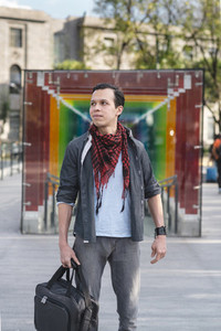 Handsome Hispanic man in kerchief on street