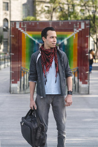 Handsome Hispanic man in kerchief on street