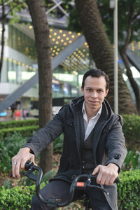 Smiling man on bicycle outdoors