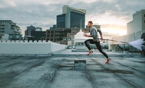 Fitness man doing workout using resistance parachute
