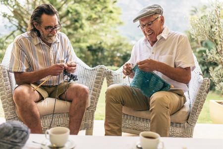 Retired male friends doing knitting