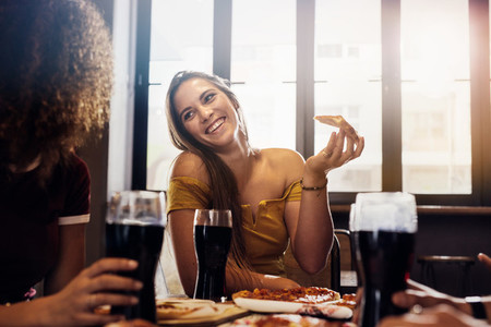 Female friends enjoying lunch at restaurant