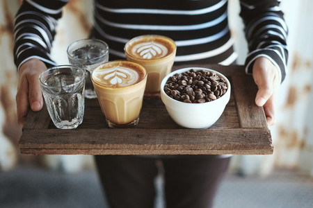 Barista woman serves coffee
