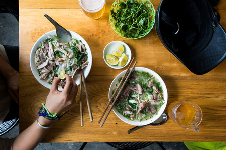 Eating Vietnamese Pho soup