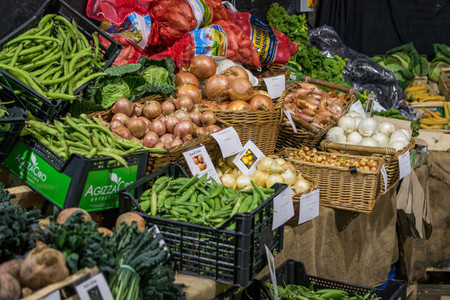 Onions and peas at market