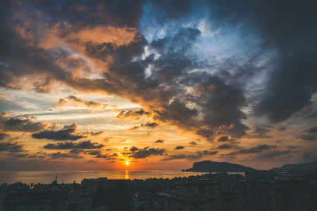 View of sunset over sea and evening dramatic sky  Alanya