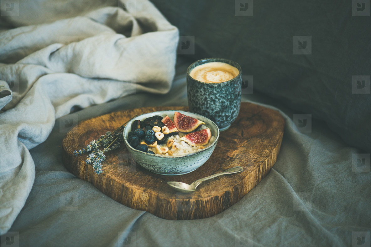 Rice coconut porridge with figs  berries and hazelnuts and coffee