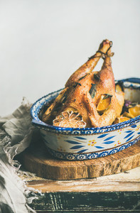 Roasted whole chicken with garlic and oranges for Christmas