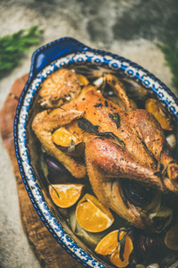 Roasted whole chicken with orange for Christmas eve celebration table