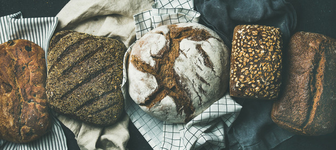 Flat lay of Various bread selection loaves  black background