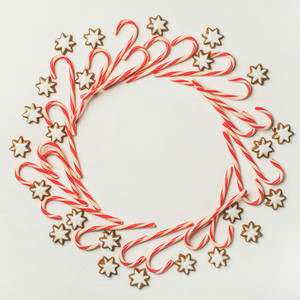 Christmas wreath pattern made from candy cane sticks square crop