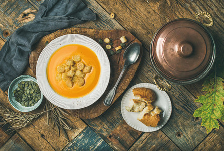 Fall pumpkin cream soup with croutons and seeds