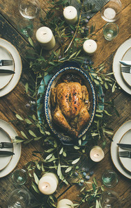 Flat lay of whole roasted chicken for Christmas over table background